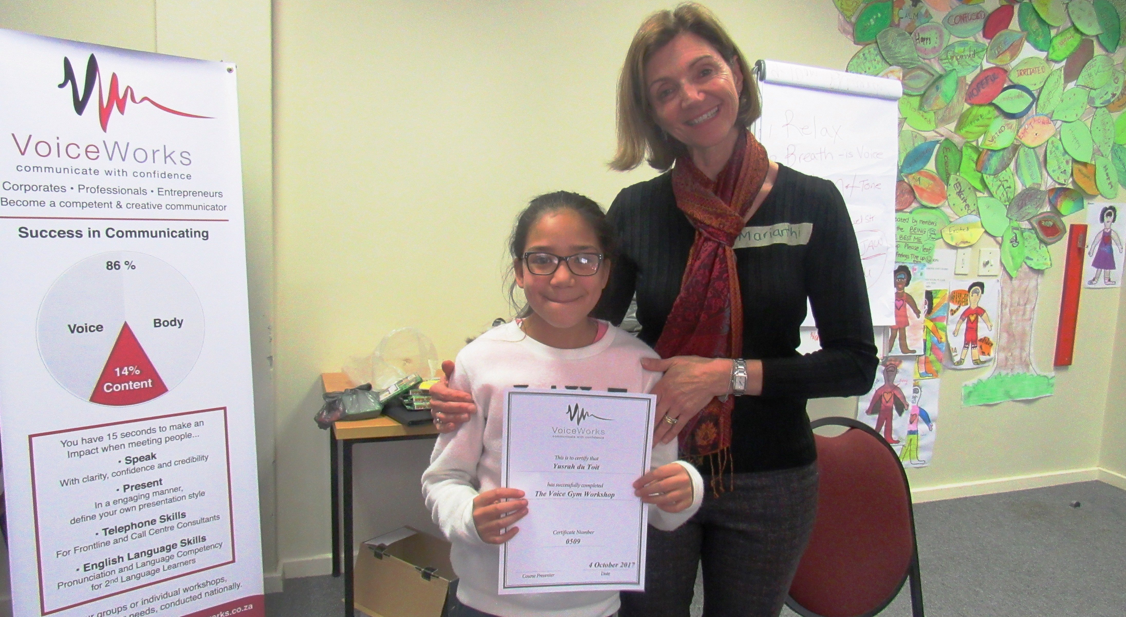 Yusrah receiving a certificate for completing the Voice Gym Workshop with VoiceWorks