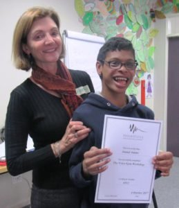 Imaad receiving a certificate for completing the Voice Gym Workshop with VoiceWorks