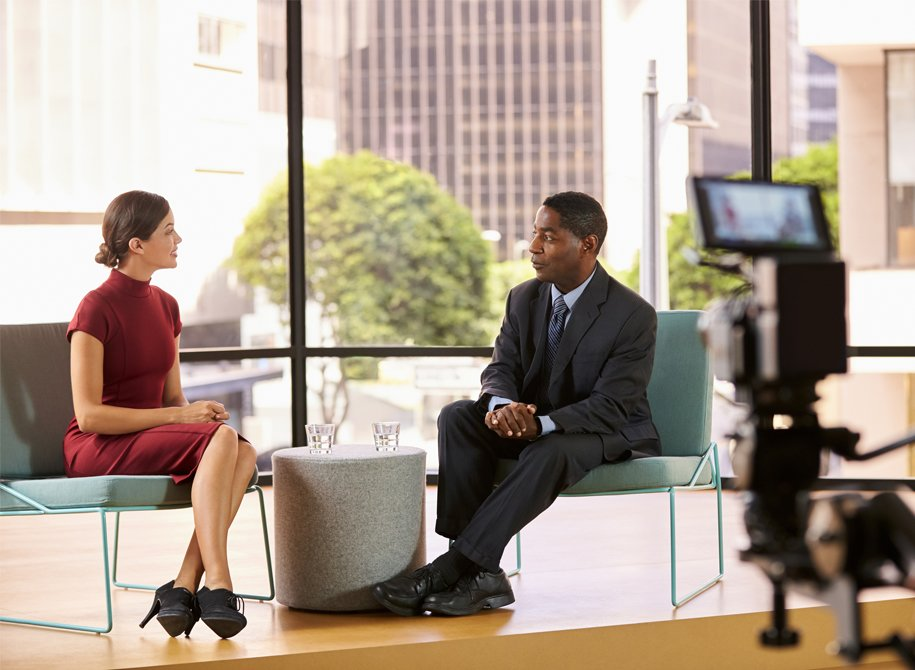 A lady and a man being recorded during a interview