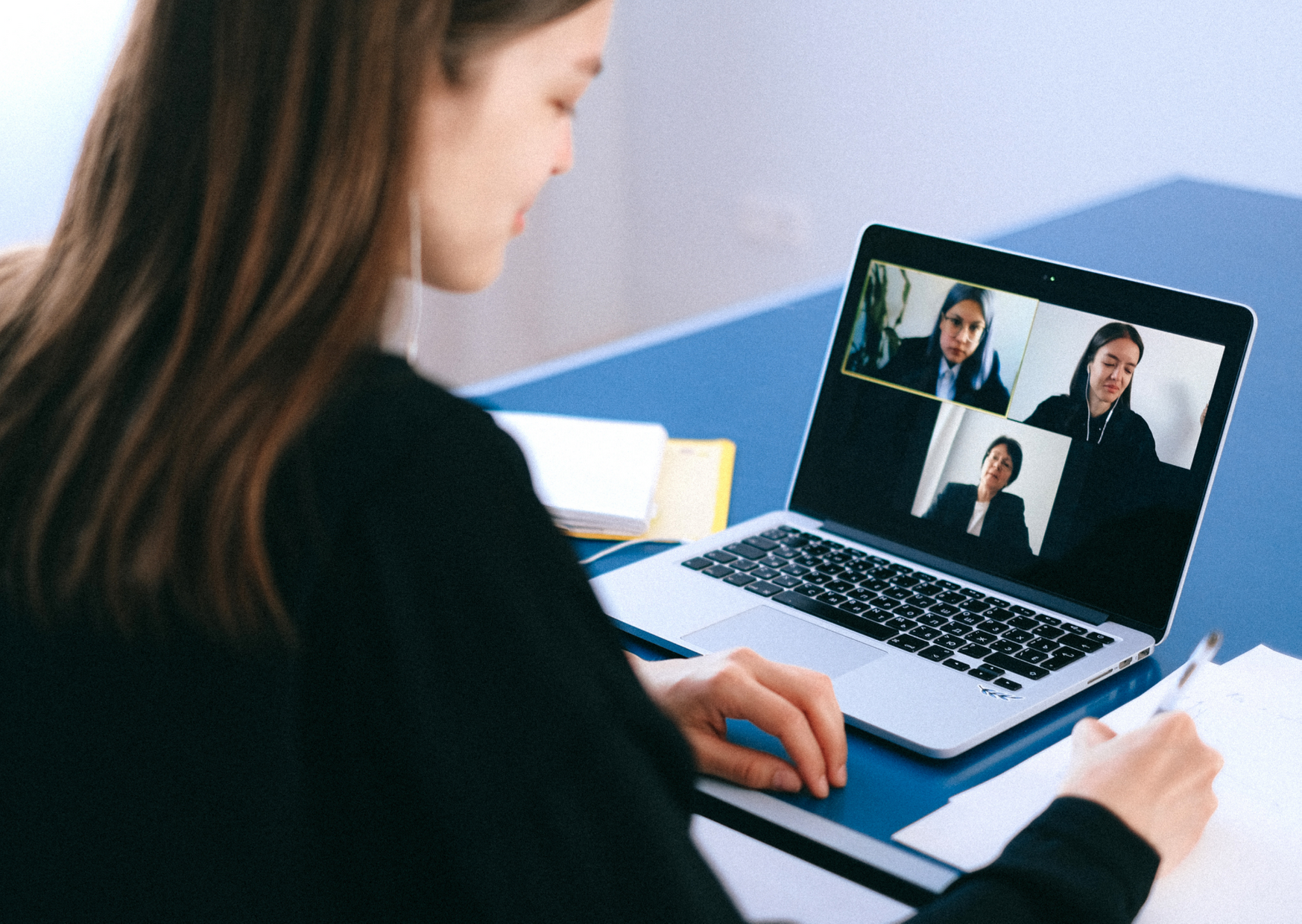 person sitting in virtual meetings with camera on